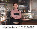 barista man at workplace in...   Shutterstock . vector #1012124707