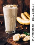 banana smoothie in glass on... | Shutterstock . vector #1012138117