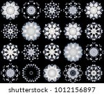 Small photo of set of white snowflakes isolated on black background. abstract blur background snowflakes. snowflake pattern of a kaleidoscope. kaleidoscopic arabesque. geometrical ornament snow pattern