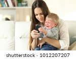 baby having a tantrum and... | Shutterstock . vector #1012207207