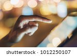 girl texting finger on screen... | Shutterstock . vector #1012250107