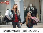 young mother and her daughter... | Shutterstock . vector #1012277017