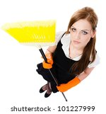 Sexy woman in orange rubber gloves cleaning the house with yellow broom  - isolated on white background - stock photo
