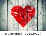 love symbol on old wooden wall background - stock photo