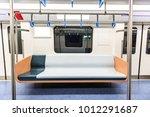 empty metro train interior... | Shutterstock . vector #1012291687