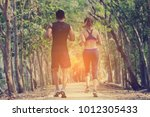 couple runner working on... | Shutterstock . vector #1012305433