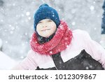 child  playing in the snow  ... | Shutterstock . vector #1012309867