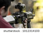shooter aiming assault rifle at ... | Shutterstock . vector #1012314103