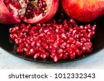 red juice pomegranate on black... | Shutterstock . vector #1012332343