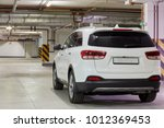 new white car at underground... | Shutterstock . vector #1012369453