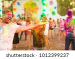guys with a girl celebrate holi ... | Shutterstock . vector #1012399237