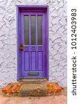purple door with worn rug and... | Shutterstock . vector #1012403983
