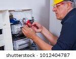 electrician fitting en... | Shutterstock . vector #1012404787