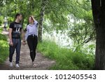 beautiful young couple on a... | Shutterstock . vector #1012405543