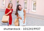 two attractive girls with... | Shutterstock . vector #1012419937