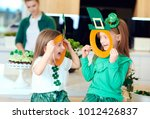 cheerful irish girl enjoying at ... | Shutterstock . vector #1012426837