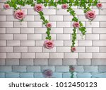 Roses On A Brick Wall. Photo...