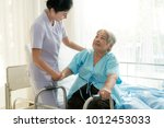 asian young nurse supporting... | Shutterstock . vector #1012453033
