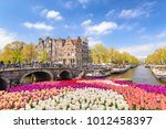 amsterdam city skyline at canal ... | Shutterstock . vector #1012458397
