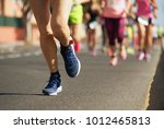 marathon runners running on... | Shutterstock . vector #1012465813