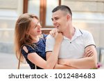 smiling couple of a guy and a... | Shutterstock . vector #1012484683