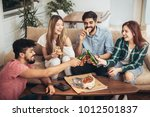 group of young friends eating...   Shutterstock . vector #1012501837