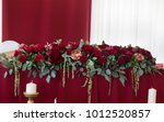 red flower arrangement on table ... | Shutterstock . vector #1012520857