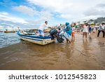 Small photo of SALVADOR, BRAZIL - FEBRUARY 02, 2016: Fishermen at the village of Rio Vermelho offer their fishing boats to celebrants at the Festival of Yemanja to take to sea to leave religious offerings.