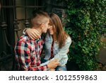 hugging smiling young loving... | Shutterstock . vector #1012559863