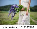beautiful girl with a bouquet... | Shutterstock . vector #1012577107