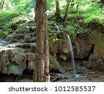 small waterfall in the forest... | Shutterstock . vector #1012585537