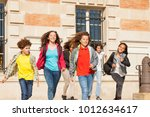 happy students with backpacks... | Shutterstock . vector #1012634617