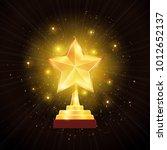 winner glowing gold star trophy ...   Shutterstock .eps vector #1012652137