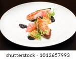grilled duck served with prunes ...   Shutterstock . vector #1012657993