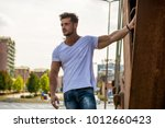 attractive man in urban setting ...   Shutterstock . vector #1012660423