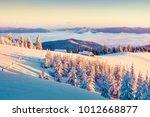 first sunlight glowing mountain ... | Shutterstock . vector #1012668877