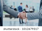 close up of businessmen shaking ... | Shutterstock . vector #1012679317