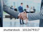 close up of businessmen shaking ... | Shutterstock . vector #1012679317