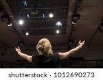 Small photo of actress singing and acting in theater play