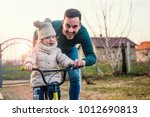 father and daughter learning to ... | Shutterstock . vector #1012690813