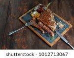 t bone steak on board   Shutterstock . vector #1012713067