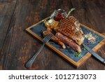 t bone steak on board   Shutterstock . vector #1012713073