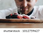 close up young chef decoration...   Shutterstock . vector #1012759627