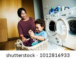 mother and son doing housework... | Shutterstock . vector #1012816933