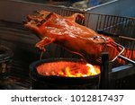 barbecued suckling pig fire... | Shutterstock . vector #1012817437