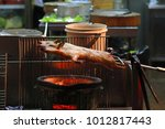 barbecued suckling pig fire... | Shutterstock . vector #1012817443