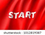 waving start flag  red field ... | Shutterstock .eps vector #1012819387