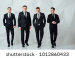 group of four men in suits...   Shutterstock . vector #1012860433