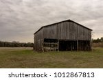 old weathered tobacco curing... | Shutterstock . vector #1012867813