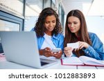 multiracial female students... | Shutterstock . vector #1012883893